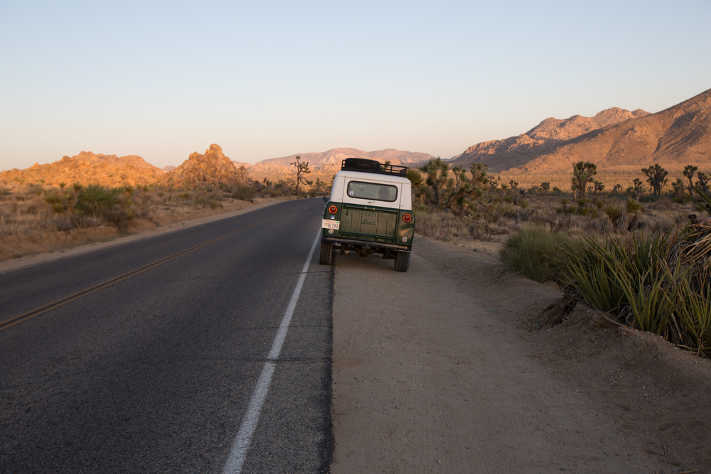 Sara and Rich Combs in their Scout in Joshua Tree, CA