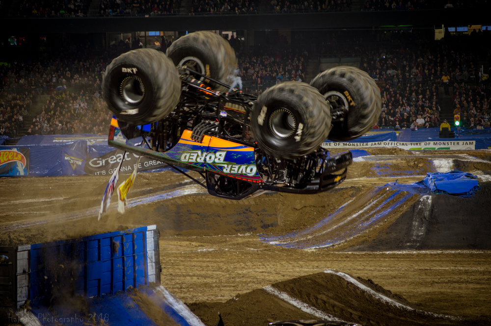 Over Bored driven by Jamey Garner going head over tires during freestyle. This truck had a pretty decent night. He took down El Toro Loco in round 1 of racing then lost to Monster Mutt Dalmatian in round 2. The two wheel competition wasn't too kind to Over Bored but in freestyle after this backflip, Jamey scored a 4th highest total of 8.808. It was a very fun and exciting run for sure.