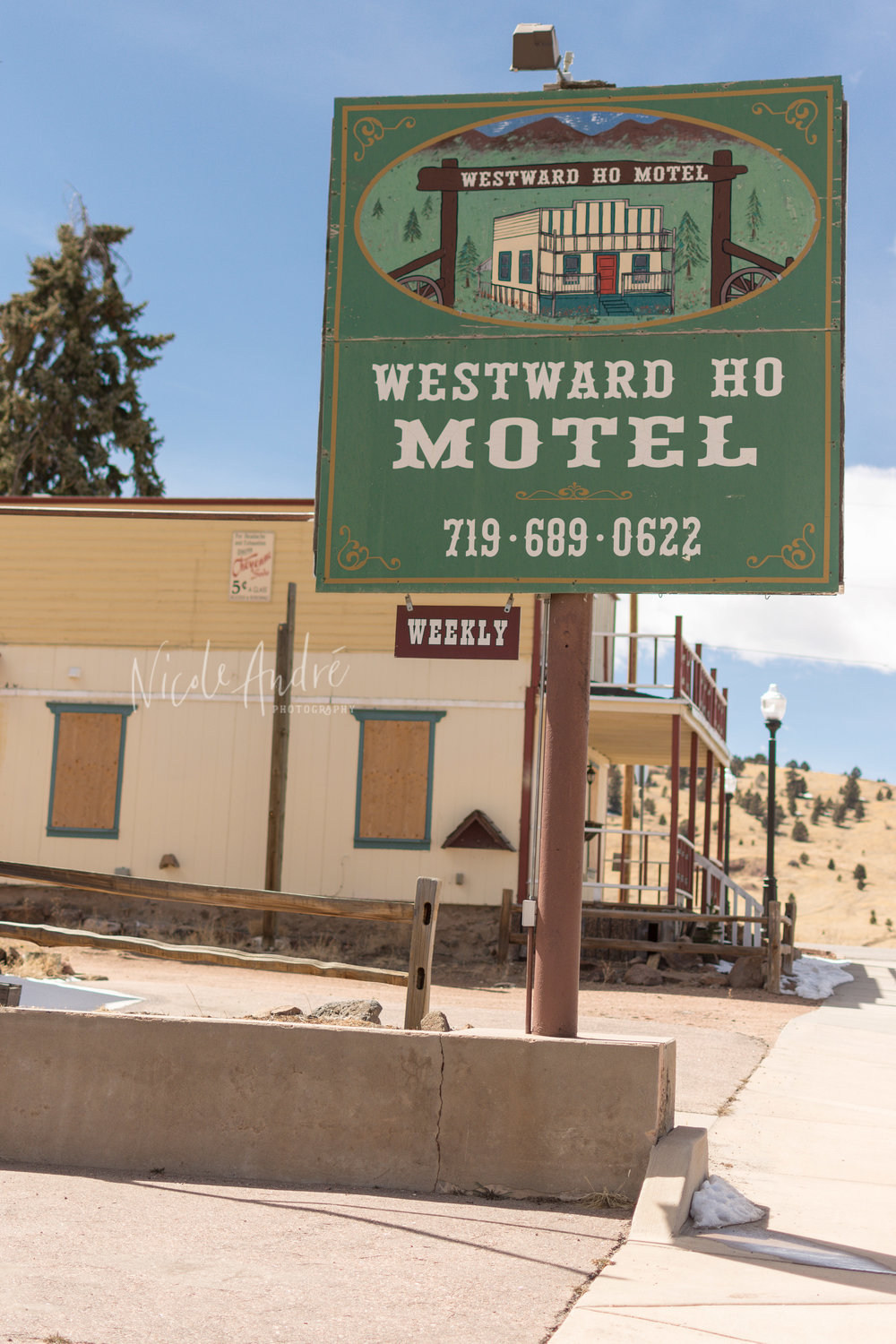 If you like ghost towns, walk past the Jail Museum to the end of the street where you will see this sign. All of the windows are boarded up, but it is still a colorful spot to check out.