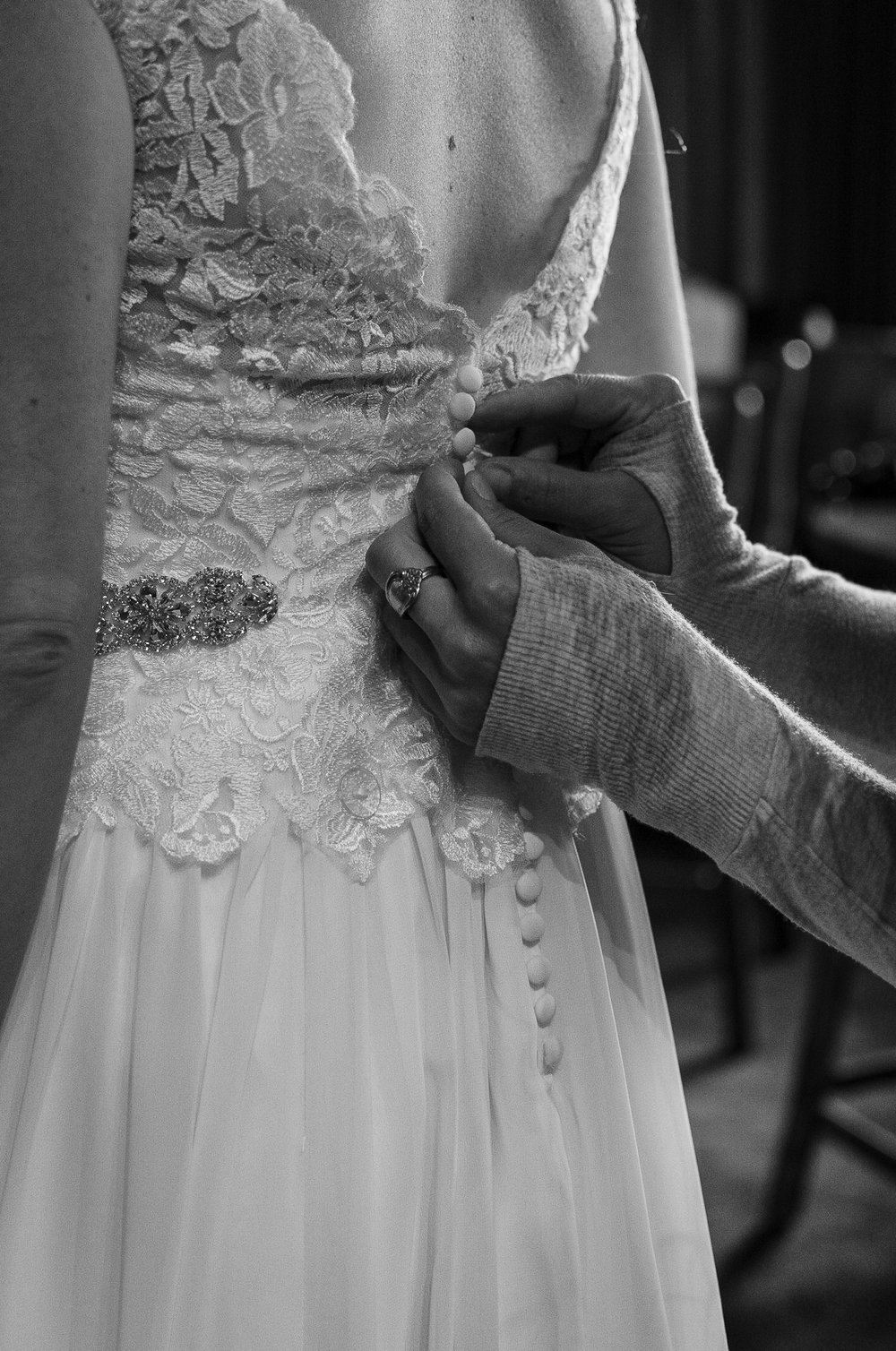 Buttoning the Wedding Dress