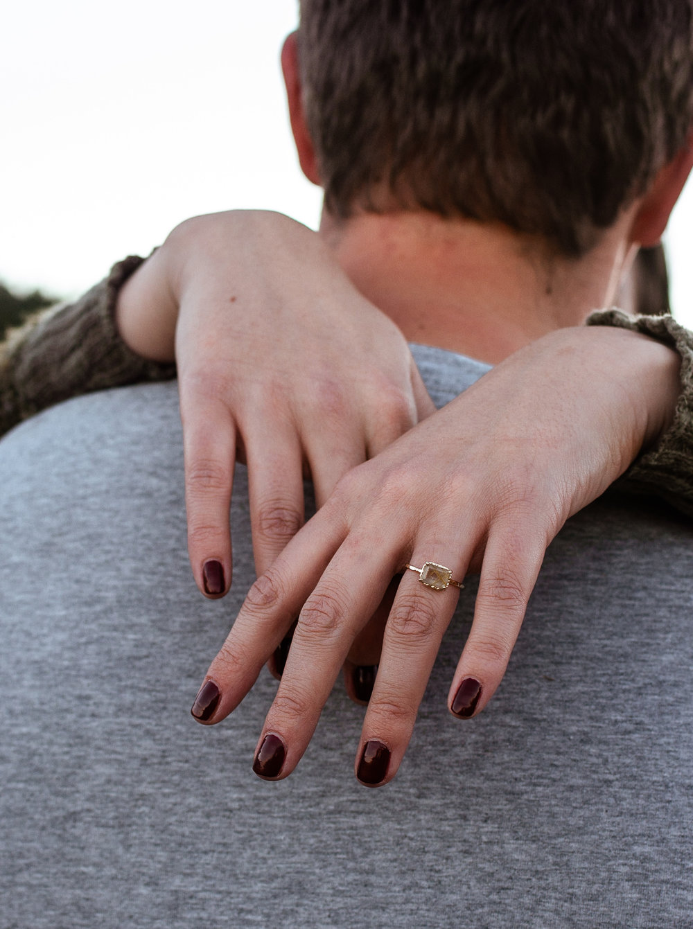 engagment ring behind neck