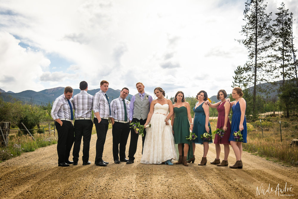 bridal party with road