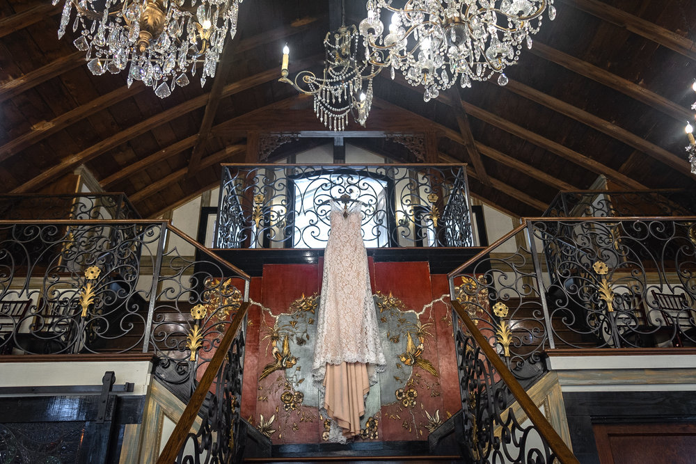 wedding dress in chandelier barn