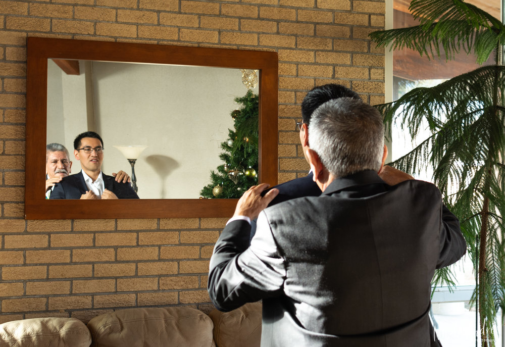 groom and father in mirror