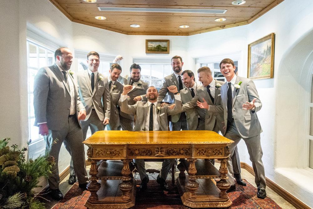 Groom + Groomsmen Cheering together on wedding day