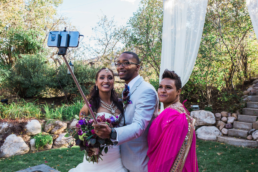 Bride and groom selfie stick with guests reception fall colors