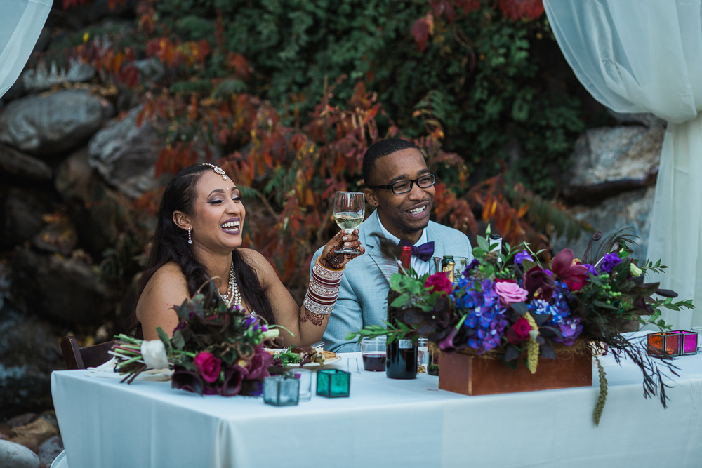 Bride and groom laughing reactions reception toasts speeches