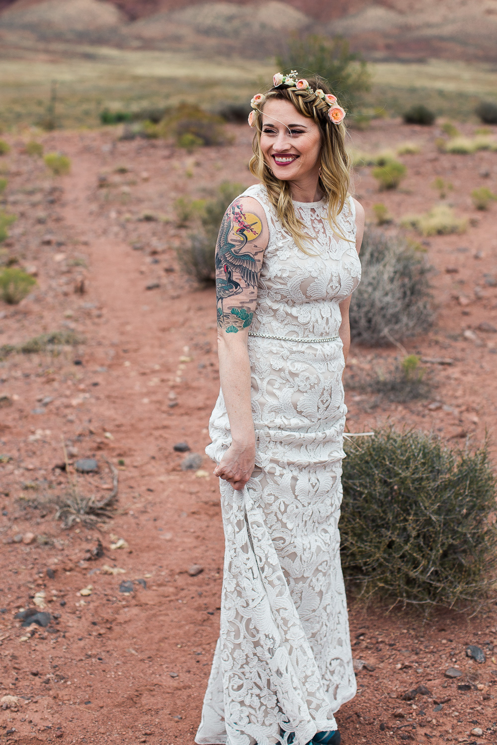 Happy tattoo bride floral crown destination wedding Moab Utah