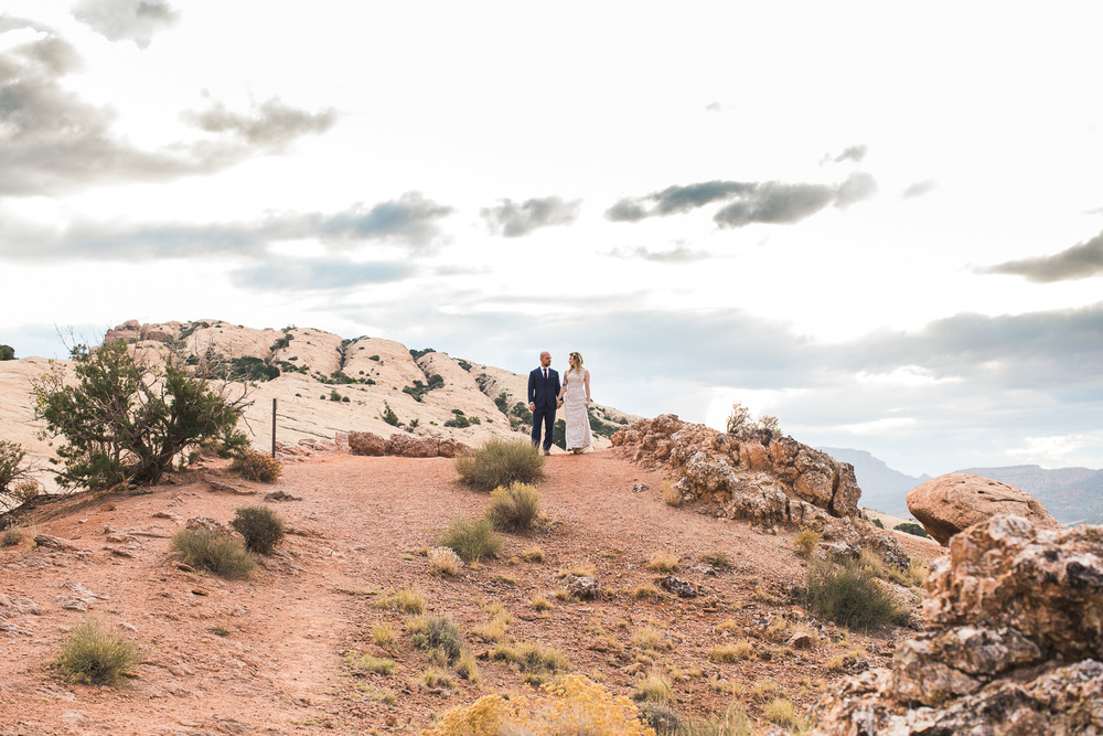 Epic landscape portrait bride groom Arches National Park Tyler Rye second shooter