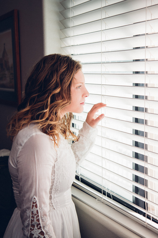 Bride getting ready portrait window light