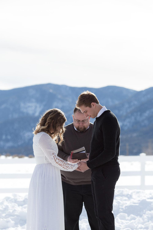 Bride and groom praying Christian religious calvary chapel ceremony
