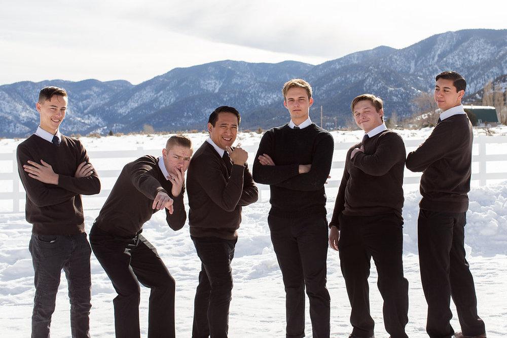 Groomsmen bridal party portraits snow mountains Utah