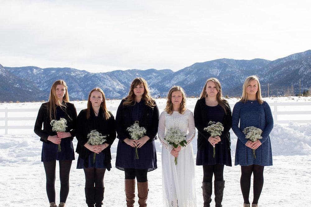 Bride and bridesmaids portrait mountain winter snow wedding
