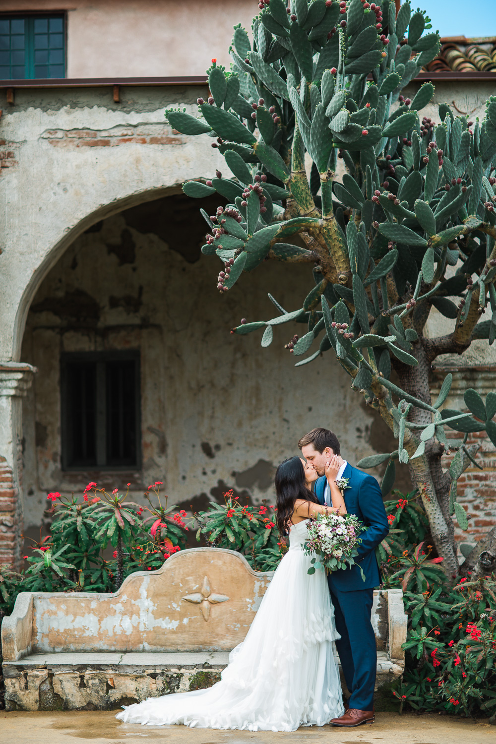 Desert spanish mission cactus bride and groom portraits