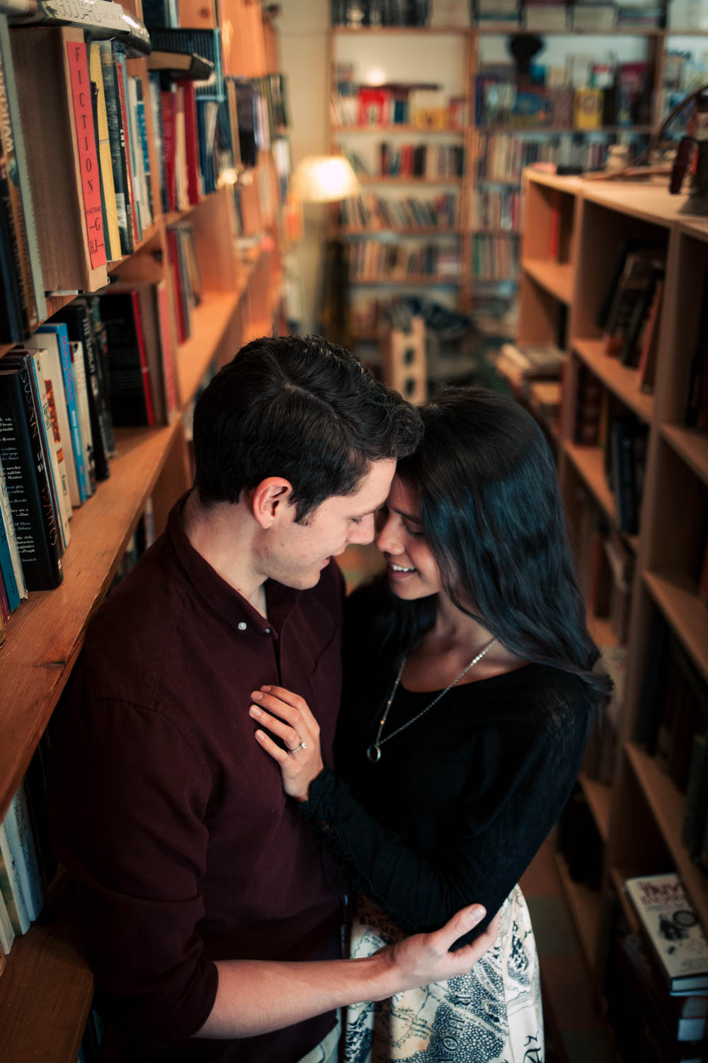 Intimate bookstore engagement photography