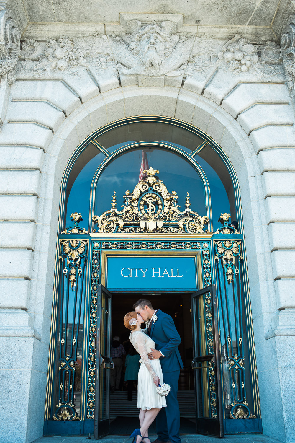 San Francisco City Hall front doors dip kissing bride and groom pictures