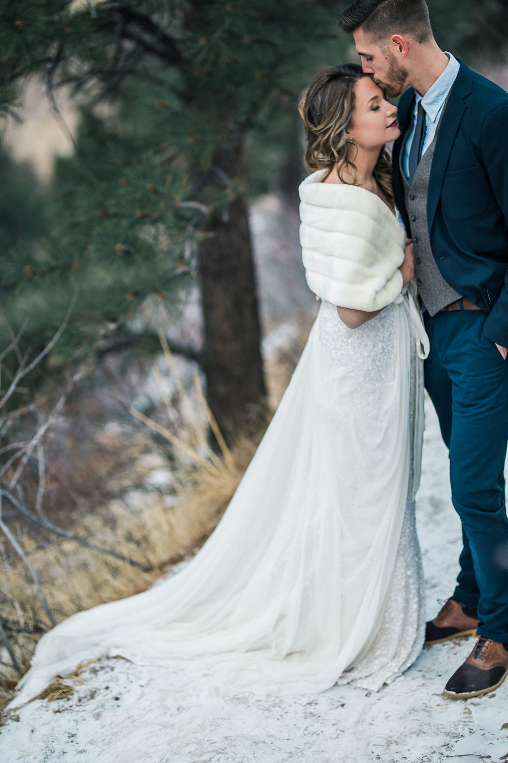 Elegant wedding couple winter elopement Colorado Rockies