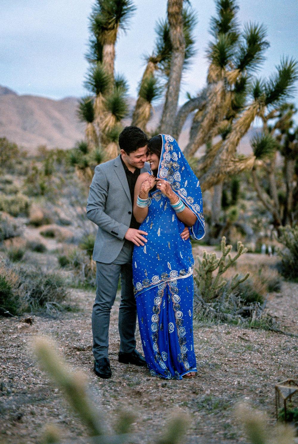 Interracial couple elopes in the Joshua tree desert traveling fine art film photographer Kyle Loves Tori Photography