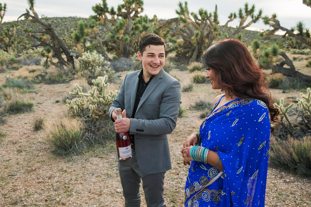 Celebratory Champagne Indian desert elopement Kyle Loves Tori Photography