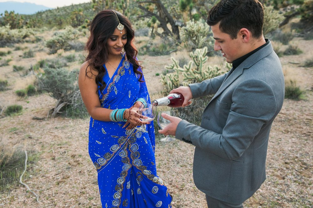 Sharing champagne at a desert elopement in Utah Kyle Loves Tori Photography