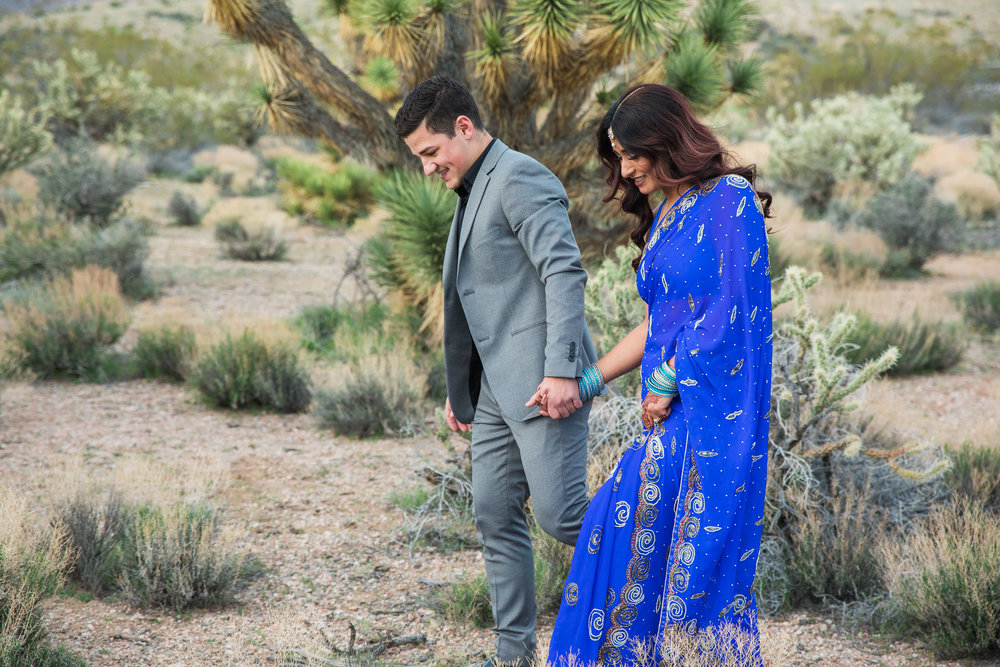 Walking in the Joshua Trees to get married Kyle Loves Tori Photography