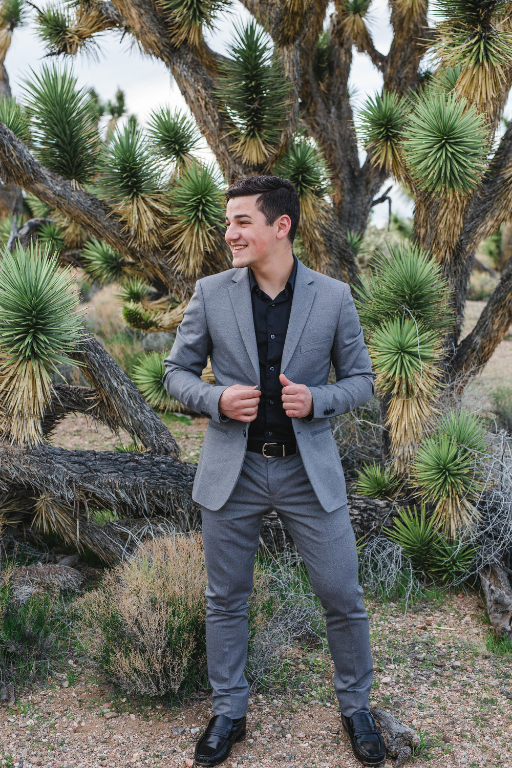 Dapper groom gray suit from Men's Warehouse Joshua Tree Elopement Kyle Loves Tori Photography
