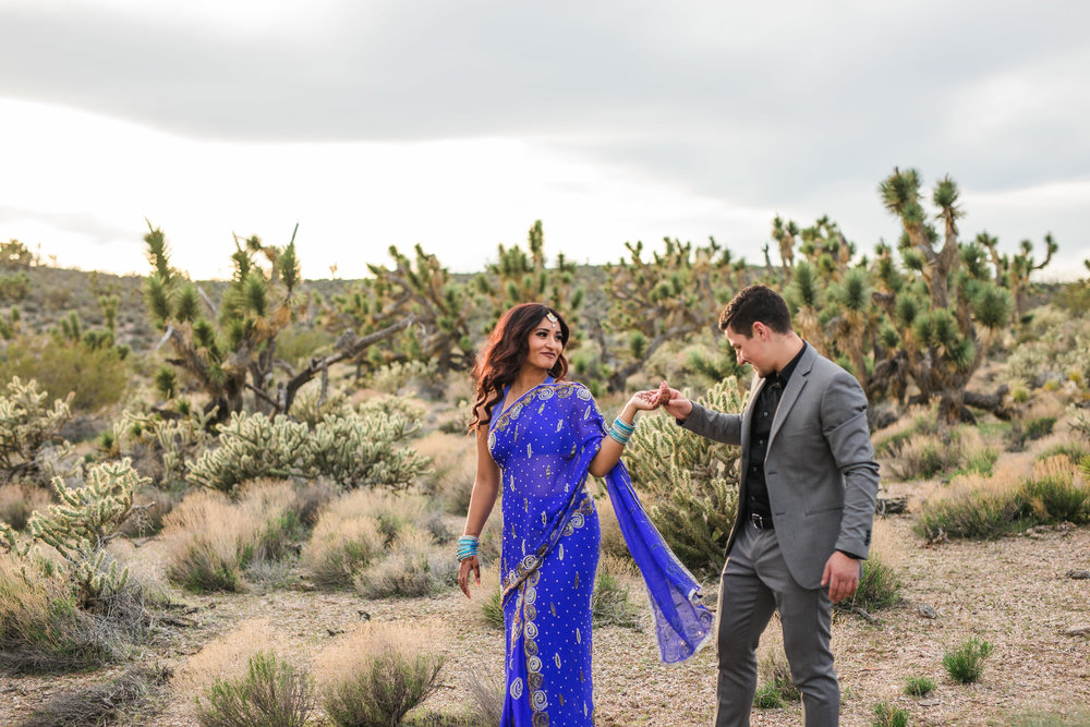 Ethnic couple dances in the desert for their elopement Kyle and Tori Sheppard photographers