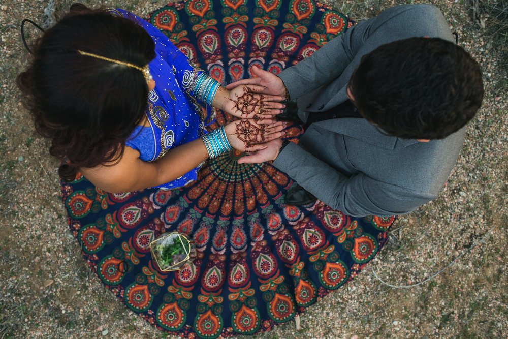 Ethnic indian bride with wedding henna mehndi on her hands Kyle Loves Tori Photography