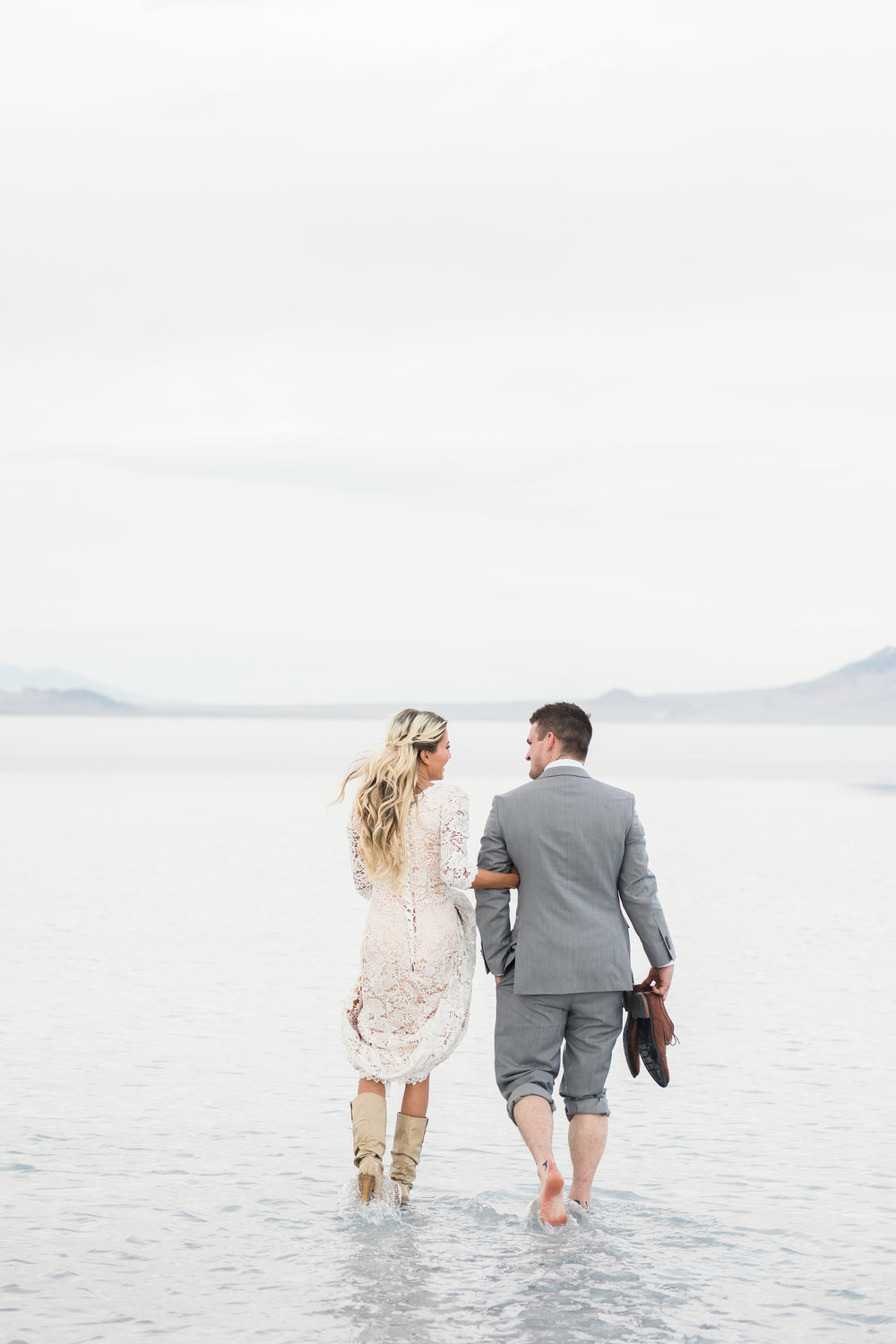 Bride and groom walking through water Bonneville Salt Flats Utah bridals