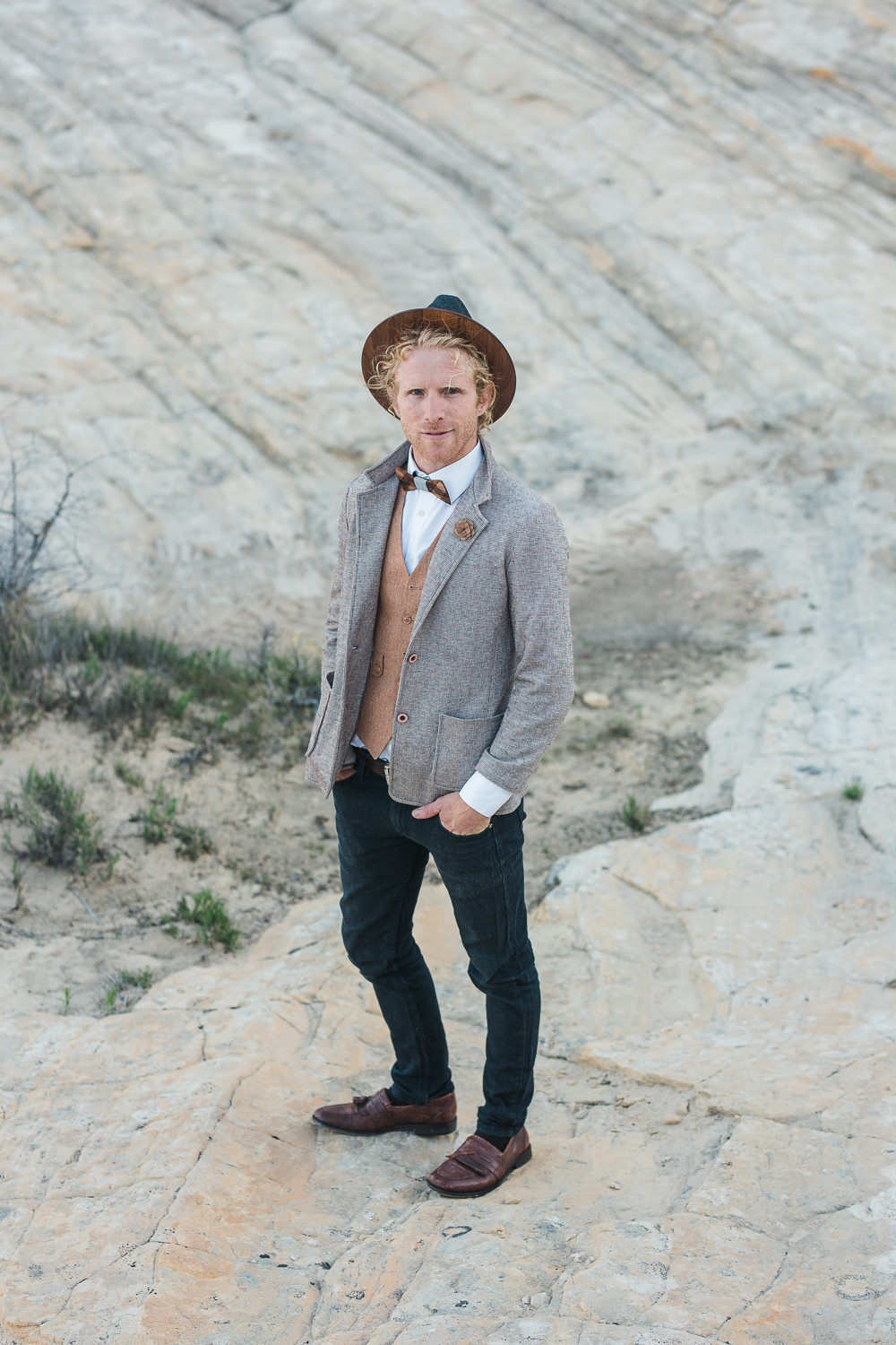 Boho groom elopes with his lady in the desert of Southern Utah