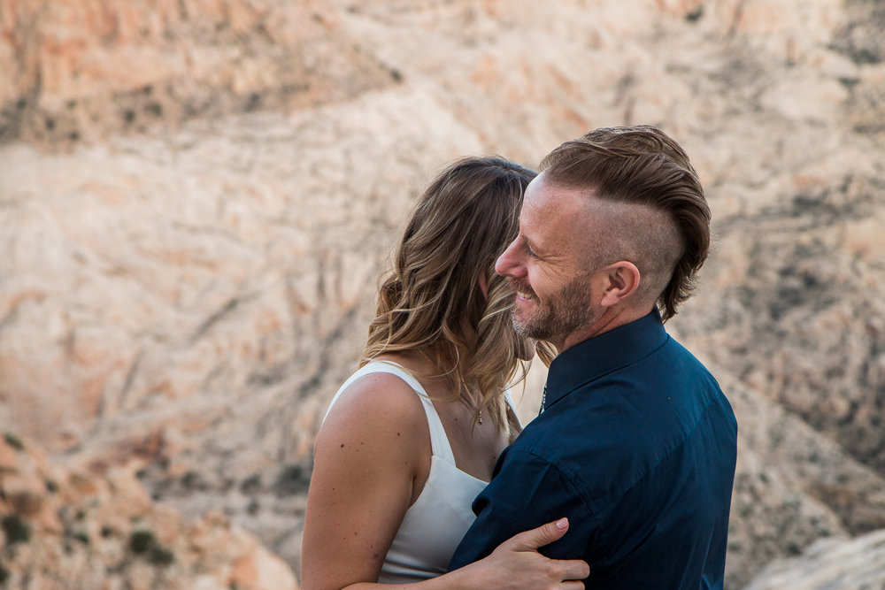 Couple shares secluded intimate vow renewal with an epic view