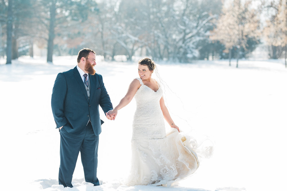 Playful bridal portraits in the snow