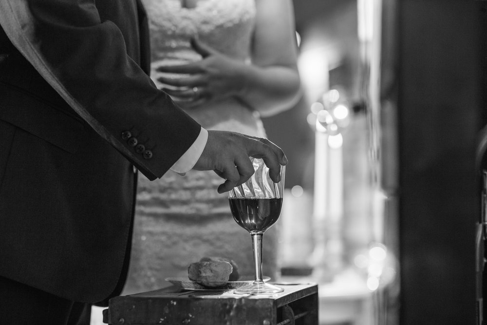 Bride and groom sharing communion at their wedding ceremony