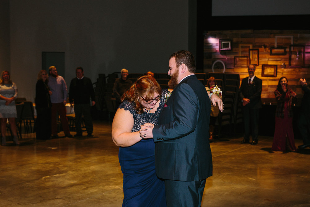 Mother son dance at winter wedding reception in Utah