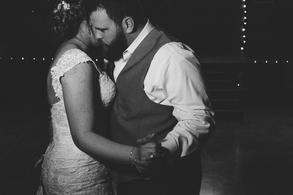 Intimate bride and groom dance after reception