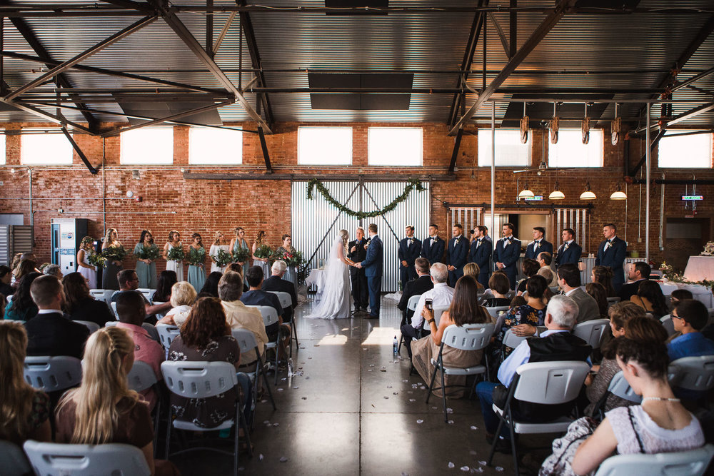 Trendy wedding ceremony inside an old plane hanger Casper WY