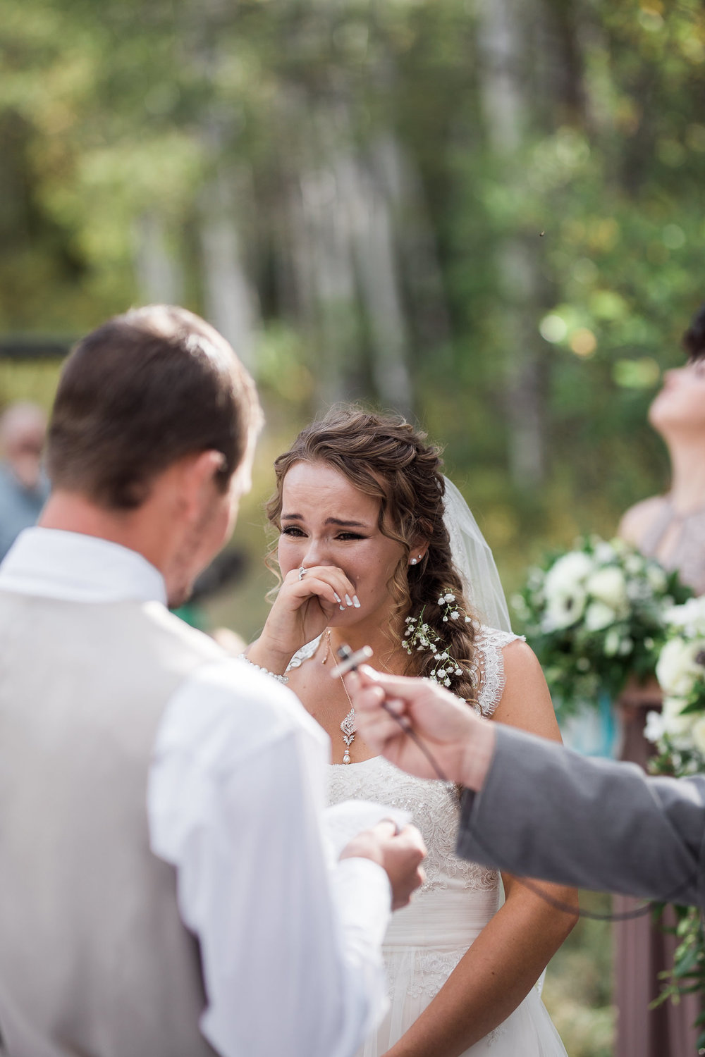 Bride tears up during wedding ceremony
