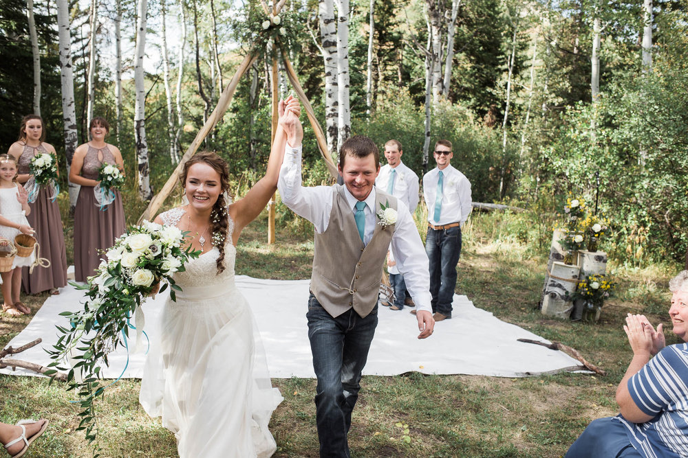 Bride and Groom leave wedding ceremony excitedly
