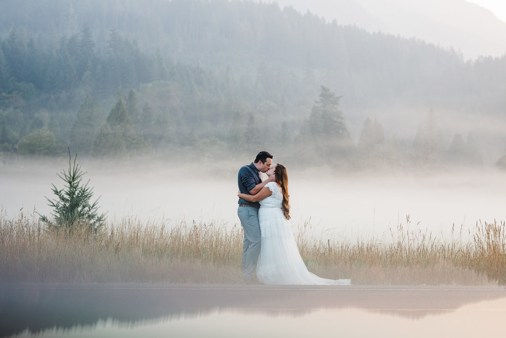 Bride and groom morning fog portrait at sunrise in Packwood Washington