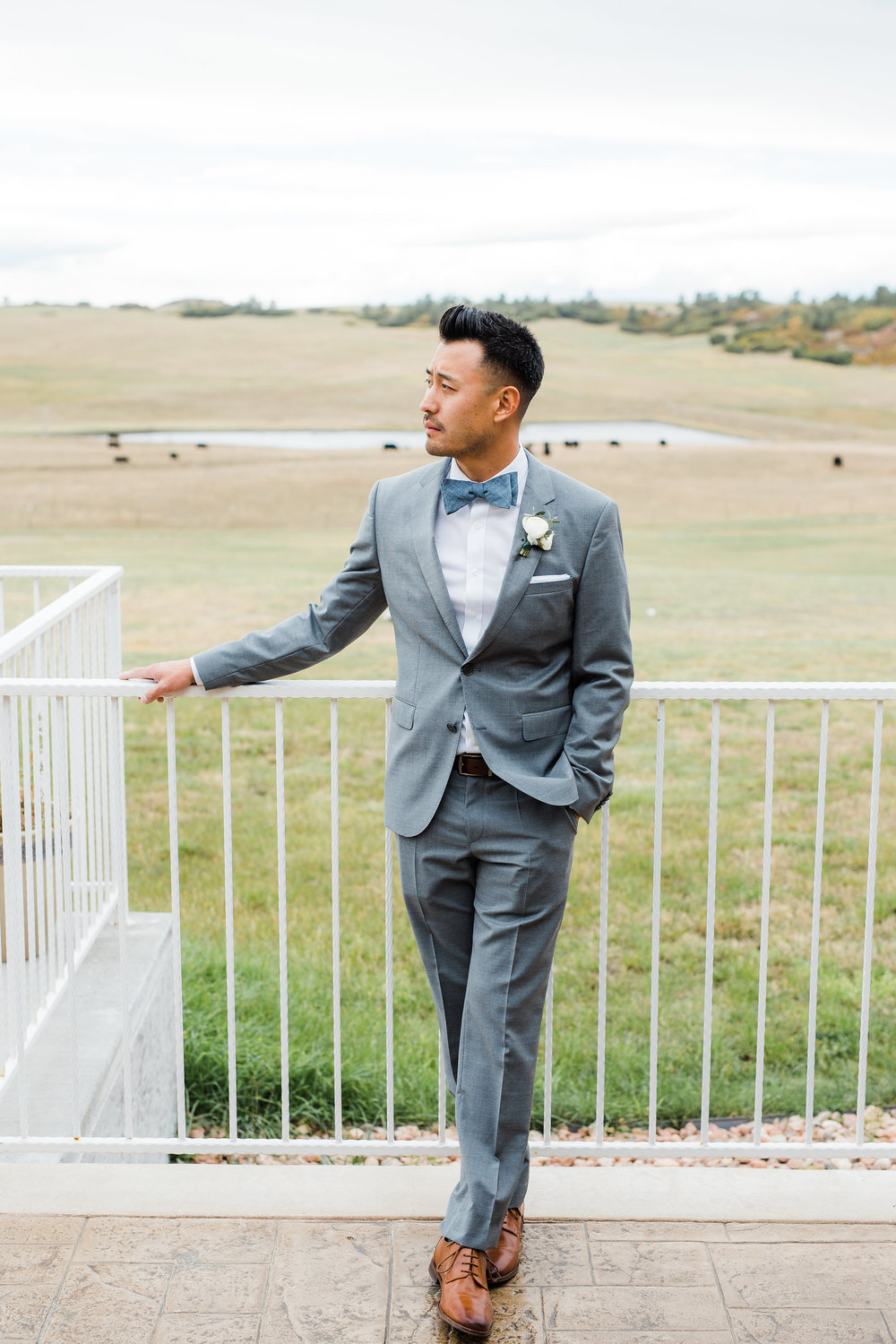 Classy asian groom portrait Flying Horse Ranch wedding