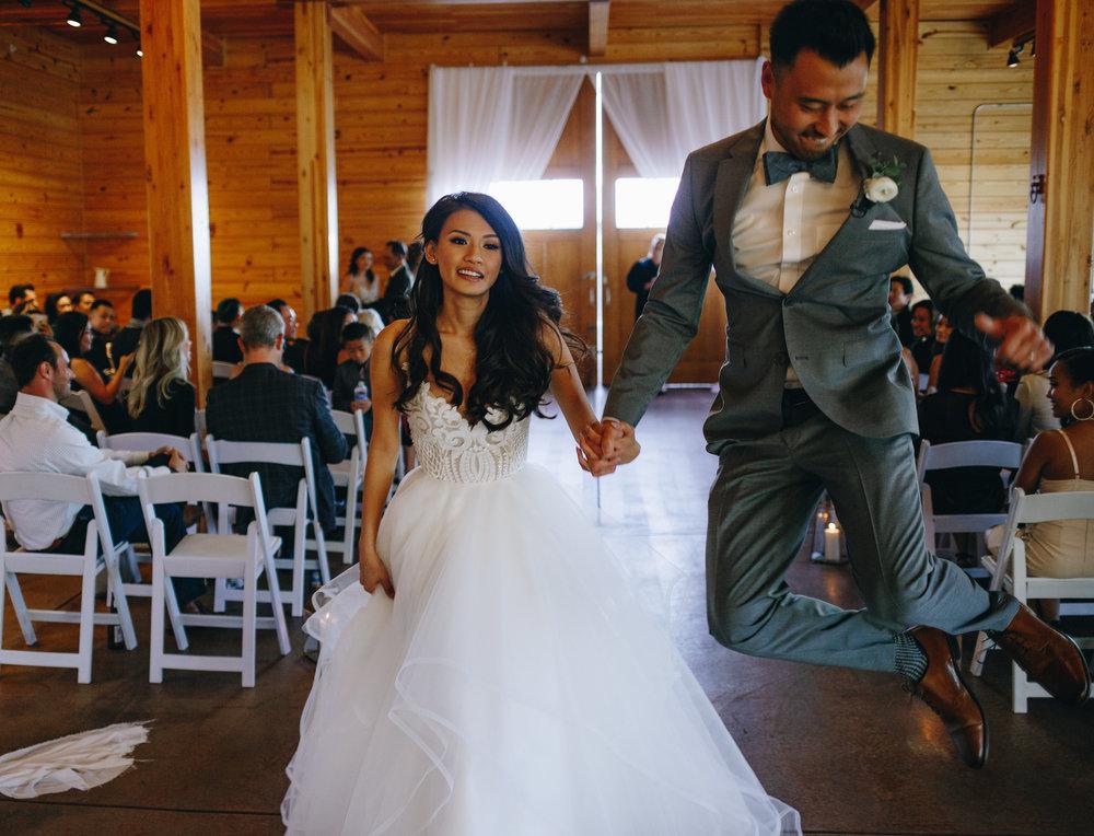 Groom heel clicking at wedding recessional