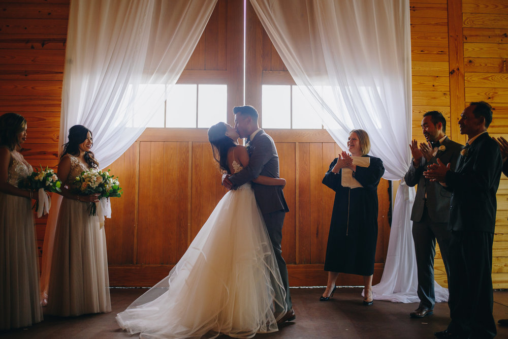 First kiss at ceremony fine art wedding in colorado