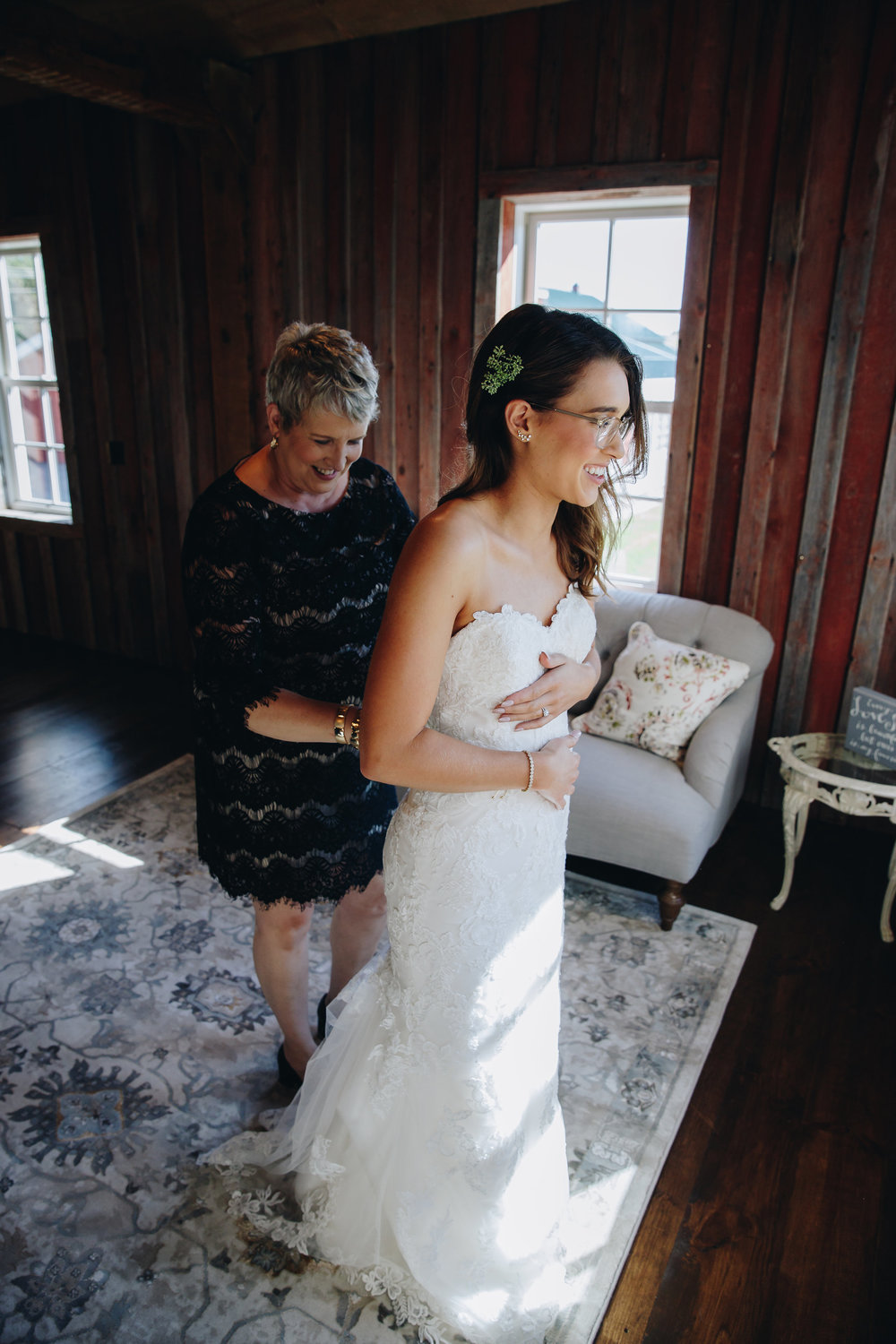 Minneapolis bride puts her wedding dress on before her first look