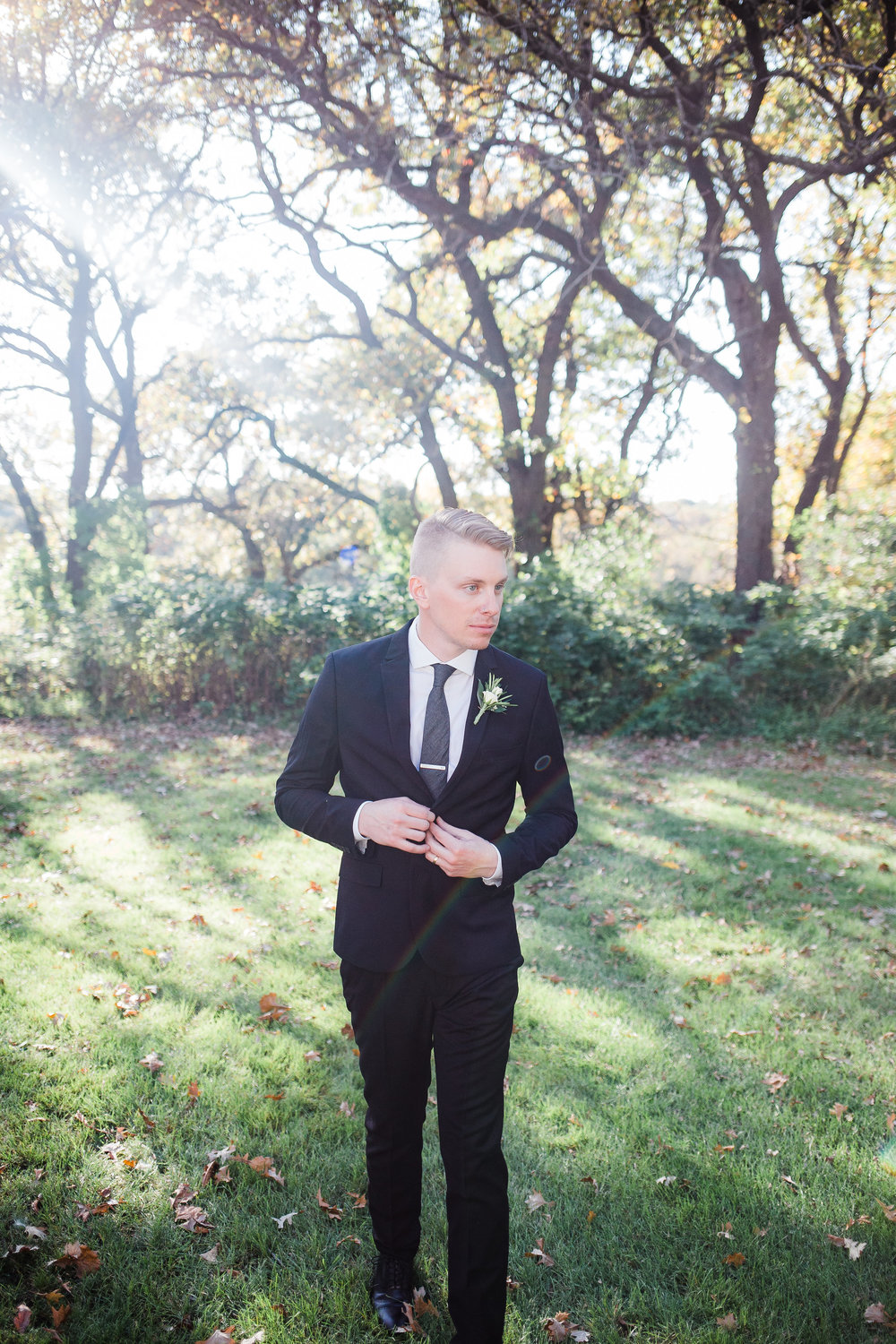 Dapper groom in his wedding day suit near Minneapolis Minnesota