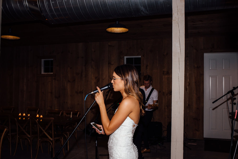 Bride sings to her groom with live band at her wedding reception
