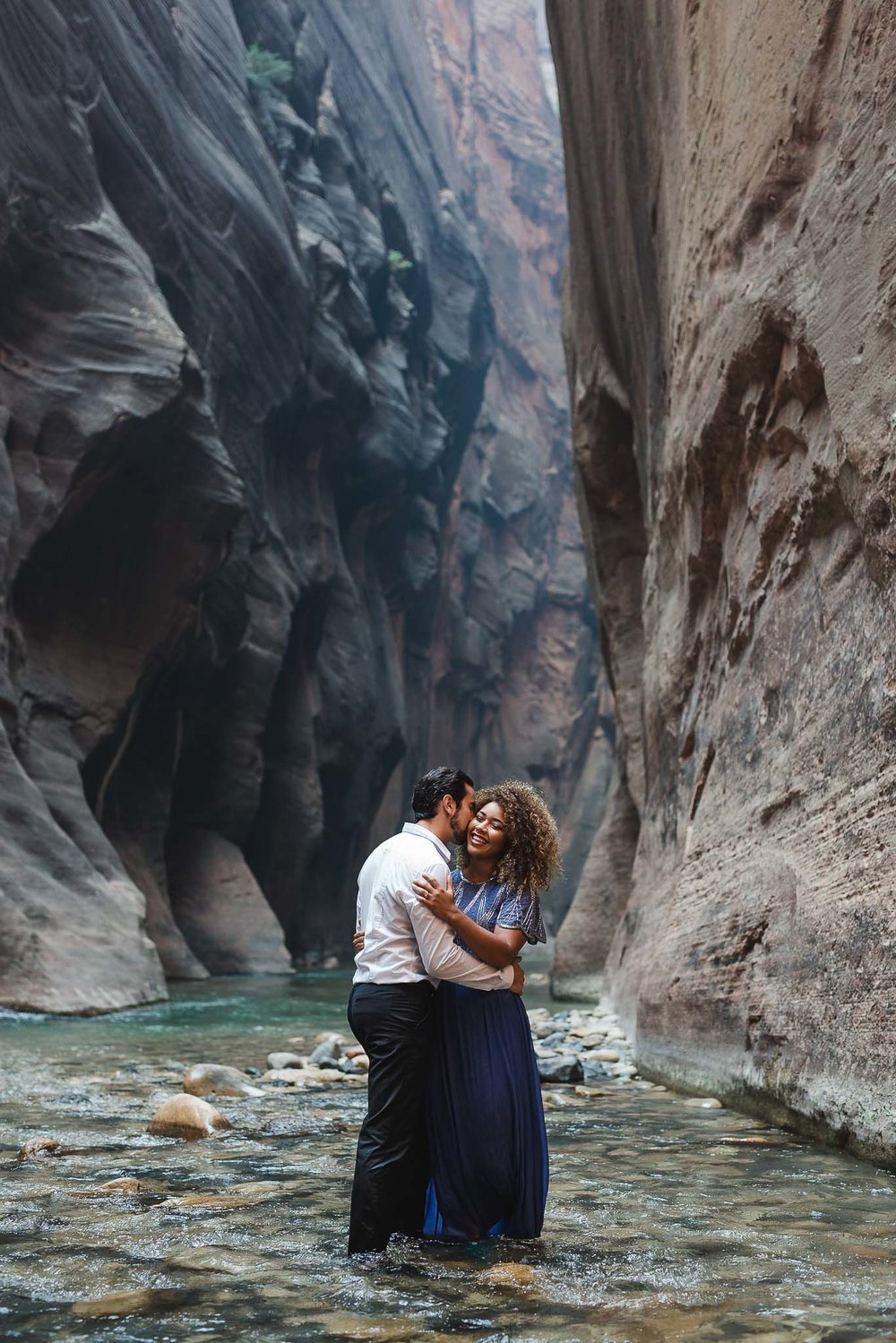 Couple stand together in the Virgin River in the Narrows at Zion National Park