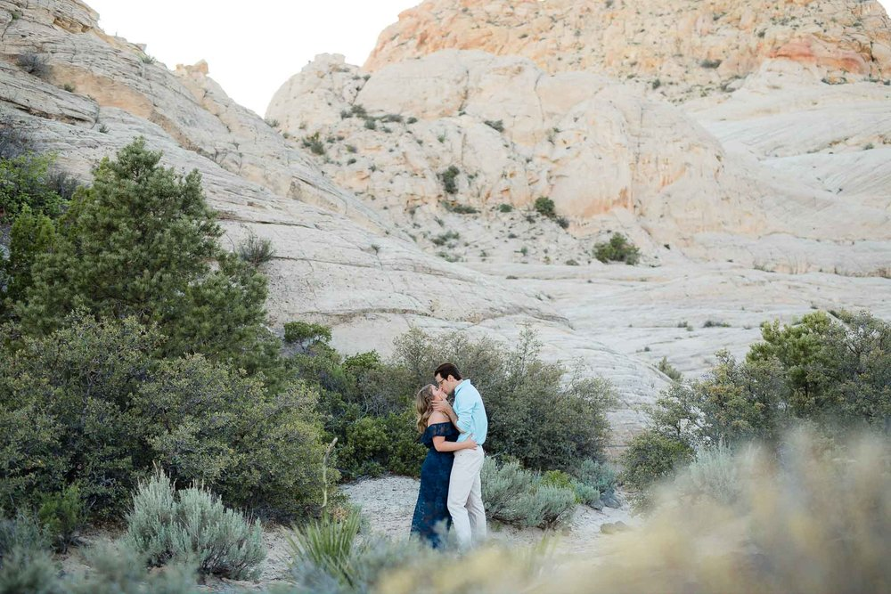 Couple kiss for engagements in Snow Canyon State Park, UT