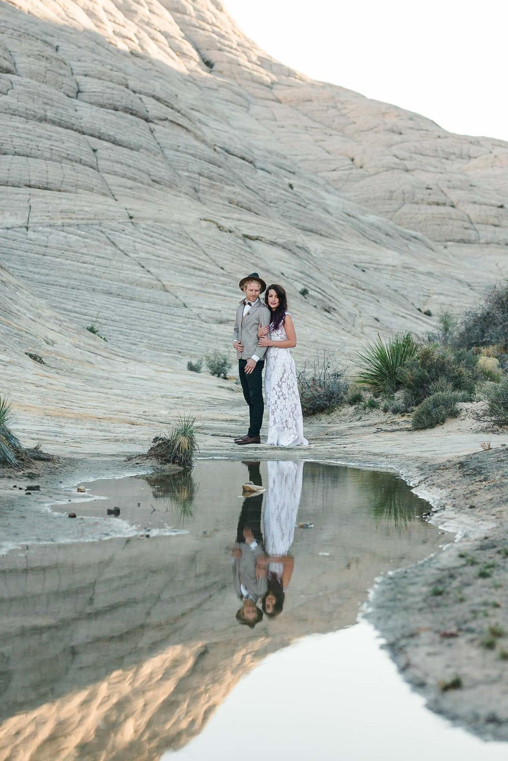 Couple pose at elopement in Snow Canyon State Park, Utah
