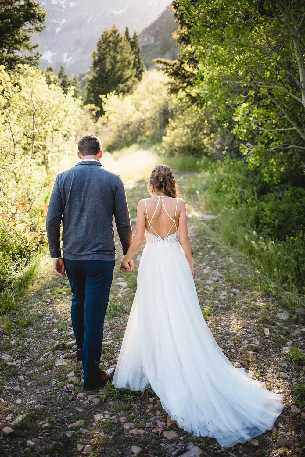 Couple walks together during wedding portraits at the Alpine Loop in Utah