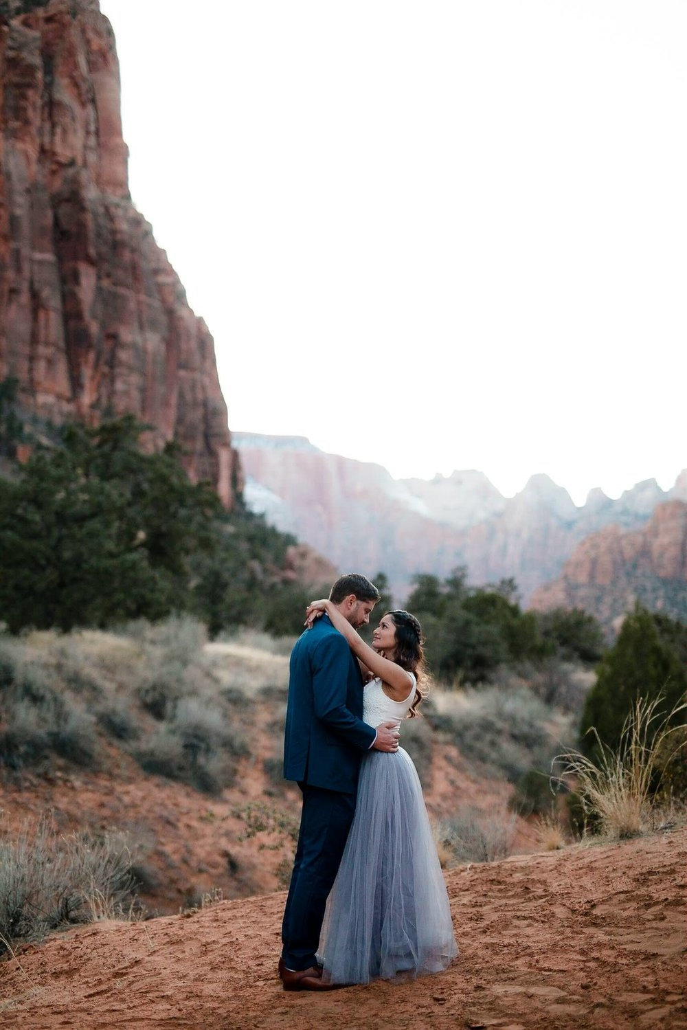 Couple pose for modern engagement photos in Zion Canyon Utah
